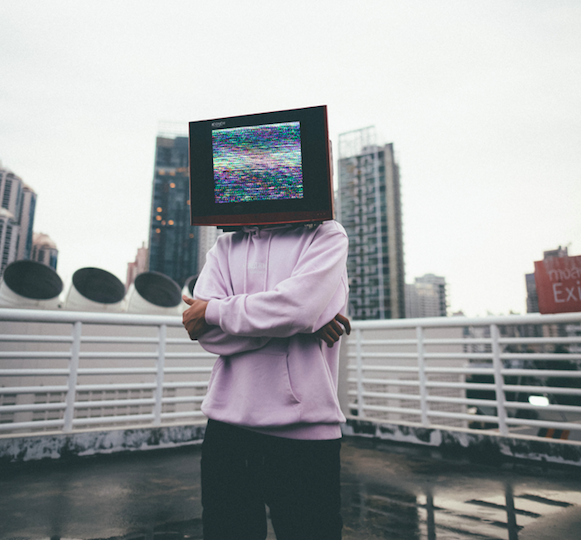 Man with a TV on his head